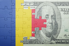 Puzzle with the national flag of romania and dollar banknote. Concept royalty free illustration