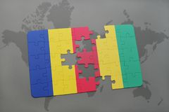 puzzle with the national flag of romania and guinea on a world map Stock Images