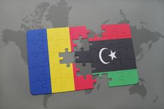 puzzle with the national flag of romania and libya on a world map Stock Images