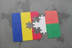 Puzzle with the national flag of romania and madagascar on a world map. Background. 3D illustration Royalty Free Stock Photography