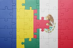Puzzle with the national flag of romania and mexico. Concept stock photos