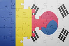 Puzzle with the national flag of romania and south korea. Concept stock photo