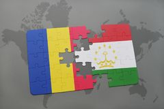 puzzle with the national flag of romania and tajikistan on a world map Stock Photo
