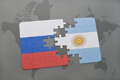 Puzzle with the national flag of russia and argentina on a world map background. Royalty Free Stock Photo