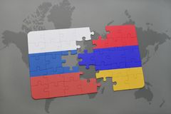 Puzzle with the national flag of russia and armenia on a world map background. Royalty Free Stock Image