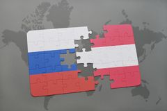 Puzzle with the national flag of russia and austria on a world map background. 3D illustration Stock Images