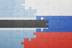 Puzzle with the national flag of russia and botswana Royalty Free Stock Image