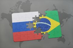 Puzzle with the national flag of russia and brazil on a world map background. 3D illustration Stock Images