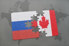 Puzzle with the national flag of russia and canada on a world map background. 3D illustration Stock Photos