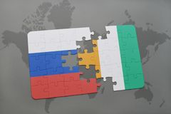 Puzzle with the national flag of russia and cote divoire on a world map background. 3D illustration Royalty Free Stock Photography
