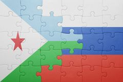 Puzzle with the national flag of russia and djibouti Stock Image