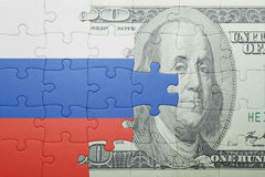Puzzle with the national flag of russia and dollar banknote. Concept royalty free illustration