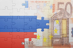 Puzzle with the national flag of russia and euro banknote Stock Photography