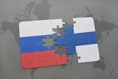 Puzzle with the national flag of russia and finland on a world map background. Royalty Free Stock Photo