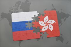 Puzzle with the national flag of russia and hong kong on a world map background. 3D illustration Stock Photo