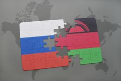puzzle with the national flag of russia and malawi on a world map background. Stock Images