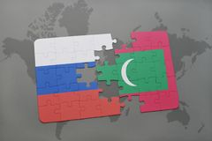 puzzle with the national flag of russia and maldives on a world map background. Royalty Free Stock Photos