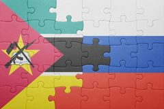 Puzzle with the national flag of russia and mozambique Royalty Free Stock Image