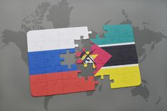 Puzzle with the national flag of russia and mozambique on a world map background. 3D illustration Stock Photos
