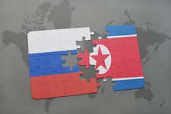 Puzzle with the national flag of russia and north korea on a world map background. 3D illustration Royalty Free Stock Photography