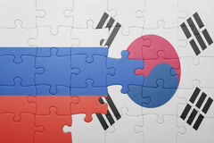 Puzzle with the national flag of russia and south korea. Concept royalty free stock photography