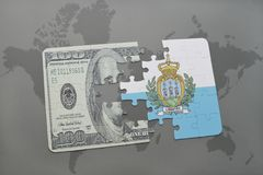 Puzzle with the national flag of san marino and dollar banknote on a world map background. Royalty Free Stock Images