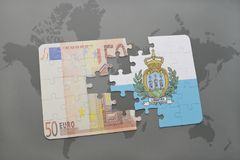 Puzzle with the national flag of san marino and euro banknote on a world map background. Stock Photos