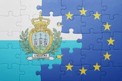 Puzzle with the national flag of san marino and european union Stock Images
