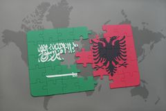 puzzle with the national flag of saudi arabia and albania on a world map background. Stock Photography