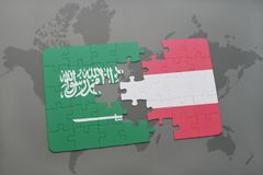 Puzzle with the national flag of saudi arabia and austria on a world map background. 3D illustration Stock Photo