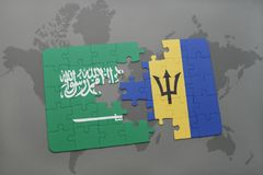 puzzle with the national flag of saudi arabia and barbados on a world map background. Royalty Free Stock Photo