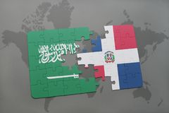 puzzle with the national flag of saudi arabia and dominican republic on a world map background. Stock Photo