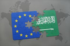 Puzzle with the national flag of saudi arabia and european union on a world map Royalty Free Stock Images