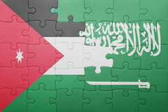 Puzzle with the national flag of saudi arabia and jordan Royalty Free Stock Photo