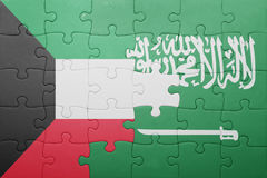 Puzzle with the national flag of saudi arabia and kuwait. Concept Stock Image