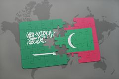 Puzzle with the national flag of saudi arabia and maldives on a world map background. Royalty Free Stock Photo