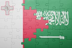 Puzzle with the national flag of saudi arabia and malta. Concept Royalty Free Stock Photos