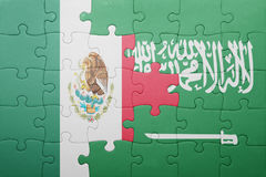 Puzzle with the national flag of saudi arabia and mexico. Concept royalty free stock image