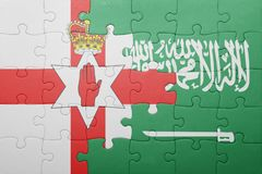 Puzzle with the national flag of saudi arabia and northern ireland Stock Photography