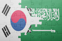 Puzzle with the national flag of saudi arabia and south korea. Concept royalty free stock photo