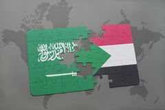 puzzle with the national flag of saudi arabia and sudan on a world map background. Stock Photography