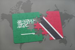 Puzzle with the national flag of saudi arabia and trinidad and tobago on a world map background. 3D illustration Royalty Free Stock Photography