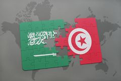 puzzle with the national flag of saudi arabia and tunisia on a world map background. Royalty Free Stock Image