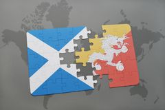 puzzle with the national flag of scotland and bhutan on a world map Royalty Free Stock Photo