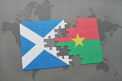 Puzzle with the national flag of scotland and burkina faso on a world map. Background. 3D illustration Royalty Free Stock Photos