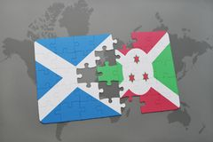 Puzzle with the national flag of scotland and burundi on a world map. Background. 3D illustration Stock Images
