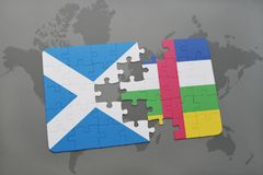 Puzzle with the national flag of scotland and central african republic on a world map. Background. 3D illustration Stock Images