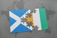 Puzzle with the national flag of scotland and cote divoire on a world map. Background. 3D illustration Stock Photo