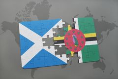 Puzzle with the national flag of scotland and dominica on a world map Royalty Free Stock Photography