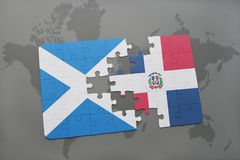 Puzzle with the national flag of scotland and dominican republic on a world map Stock Photos